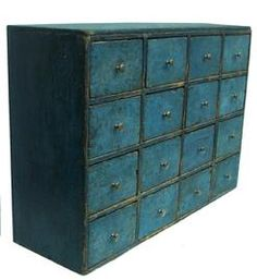 Y158 Mid 19th century Pennsylvania  Apothecary,with beautiful blue paint, sixteen drawers,  square nailed construction, the wood is poplar circa 1830 ,Measurements are: 8 1/2 deep x 18 1/2 tall x 26 1/4 wide