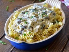 Chicken Pasta with Artichoke Spinach Cream Sauce - A bubbling pasta dish that oozes with cheese and flavor.   Ideahacks.com