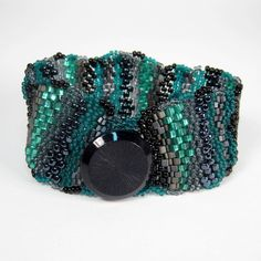 Beautiful colors in this cuff bracelet. Def. my style