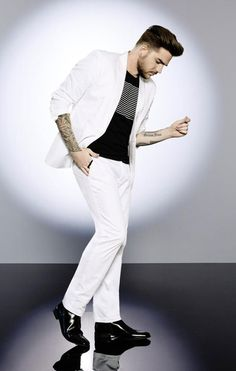 Every bit the showman, Adam Lambert shows us how head-turning summer style is done. He hits all the right notes in INC International Concepts Adam flag tee, Collins slim-fit blazer and pants.