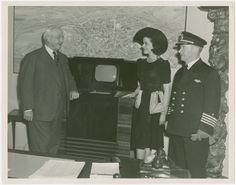"Radio Corporation of America (RCA) - Harvey Gibson, """"Miss Television,"""" and James E. Robert standing with television From New York Public Library Digital Collections."