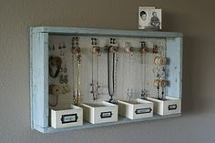 This gives me an idea for organizing mg jewelry at my boyfriend's... I'm sure I can find a few scraps of wood and a couple of hooks in grandpa's garage.  [DIY jewelry organization]