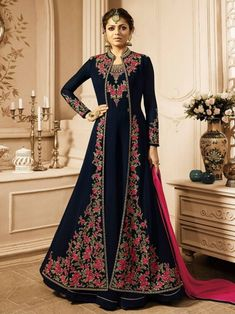 Drashti dhami navy blue designer jacket style suit online which is crafted from georgette fabric with exclusive embroidery and hand work. This stunning designer jacket style suit comes with santoon bottom and chiffon dupatta.