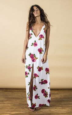 A very chic summer dress with deep V, cross detail at the back and thigh high split to front.