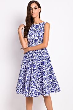 the dress featuring vintage floral print. boat neckline. sleeveless. a-line silhouette.