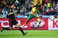 Siphiwe Tshabalala of South Africa scores the first goal during the 2010 FIFA World Cup South Africa Group A match between South Africa and Mexico at Soccer City Stadium on June 2010 in Johannesburg, South Africa. Soccer City, Football Soccer, Best Player, Fifa World Cup, Soccer Players, South Africa, How To Memorize Things, Challenges, Exercise