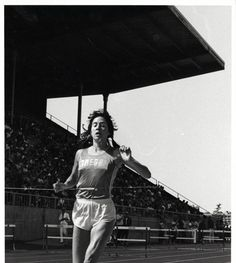 Black and photo of University of Oregon distance runner Eryn Forbes at the finish tape of a race held at Hayward Field in 1981. ©University of Oregon Libraries - Special Collections and University Archives