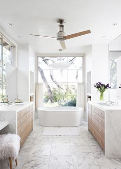 Home Tour: Tasteful and Timeless in Austin// fur stool, modern bathtub, marble