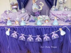 Lovely dessert table, banner and mini cakes at a Sofia the First girl birthday party!  See more party planning ideas at CatchMyParty.com!
