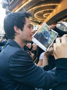 Here is a picture of Dylan signing photographs :)