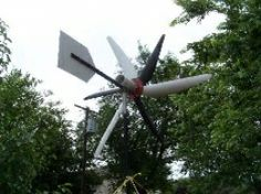 Homemade wind-powered generator constructed from a 5-amp permanent magnet DC motor, a 40-amp diode, PVC pipe, sheetmetal, flanges, square tubing, and hose clamps