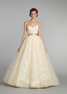 Buttercup tulle ball gown, sweetheart neckline, sheer corseted Alencon lace bodice, gold silk ribbon at natural waist, circular box pleated tulle skirt accented with Alencon lace applique, chapel train