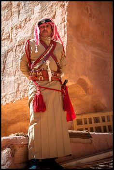 A member of the Royal Bedouin Police, dressed in uniform, standing guard at Petra (Jordan) | ©Anita & Rob