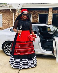 Beautiful Black Xhosa Umbhaco Dress With Red Apron, Red Beaded Cap and Beaded Stick South African Dresses, South African Traditional Dresses, African Maxi Dresses, African Print Pants, African Print Dress Designs, African Print Fashion, African Prints, African Wedding Attire, African Attire