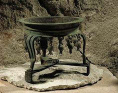 SYRIA CULT 2ND-1ST MILL.BCE Bronze tripod hung with pomegranates - a symbol of fertility reminiscent of the decorations of the Solomonic temple in Jerusalem. From Ugarit,Syria. Late Bronze H: 12 cm, 14,3 cm across AO 11606 Louvre, Departement des Antiquites Orientales, Paris, France