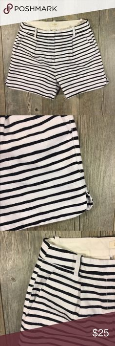 J. Crew white black stripe pleated shorts J. Crew white black stripe pleated shorts. Zipper in front. Pockets on side. Belt loops. 13 1/2 long. 4 1/2 inch inseam. Faux pockets in back. Cotton. Tag reads size 0 J. Crew Shorts