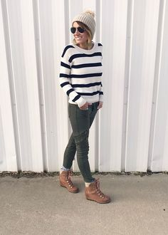 Olive jeans with black and white stripes.