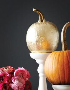 gilded pumpkin: spray a clean pumpkin with adhesive and then lay over gold leaf foil (or even aluminum foil) and press foil into creases using your hands or a paintbrush