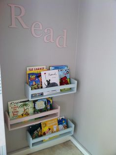 Hand made book shelves, inspired by the ikea spice racks- painted in Farrow and Ball Camomile and borrowed light.
