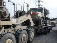 Irony my army M1070 hauling a marine transpo truck in iraq