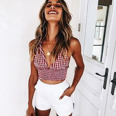 Cute red and white gingham top with white shorts.