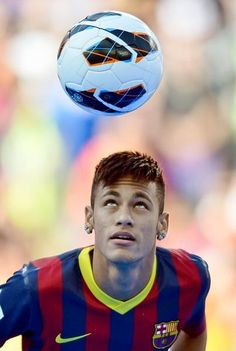 In this June 3, 2013 file photo, FC Barcelona's new signing, Neymar controls the ball during his official presentation at the Camp Nou stadium in Barcelona, Spain. As the player carrying Brazil's hopes for a World Cup title at home, Neymar is expected to attract most of the attention at the Confederations Cup. After his high-profile transfer to Barcelona, the scrutiny is only likely to increase. (Manu Fernandez/AP)