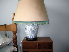 Guest room. lampshade re-jigged by me with ribbon and shell beads