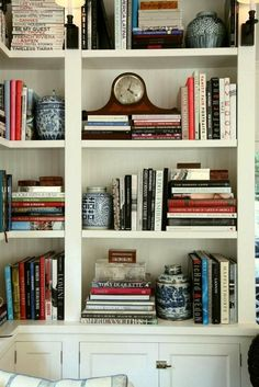 How to Style a Bookcase by Laurel Bern | Westchester County Interiors | Chinoiserie blue and white ginger jars used in book case styling. cool!