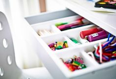 We've taken a cutlery tray and placed it inside the desk drawer to give all those creative tools, like pens and paint, a home. It can stay hidden from view, or it can be taken out and used as a desktop organiser.