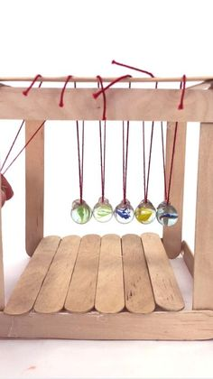 Learn how to make a simple Newton's Cradle, the classic science project demonstrating momentum! Science Projects For Kids, Science Experiments Kids, Science For Kids, Activities For Kids, Stem Projects, Educational Activities, Simple Projects, Science Crafts, Fair Projects
