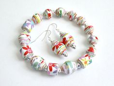 Bright Floral, PAPER BEAD Bracelet and Dangle Earrings Set - custom sizing, shipping included. $24.00, via Etsy.