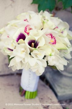 Such an elegant bouquet with picasso calla lilies and white orchids!