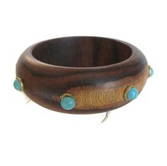 This is an awesome Wood Bangle Bracelet with Faux Turquoise Studs Vintage!  This bracelet is crazy cool – with a fabulous natural design of the wood and added touch of faux... #vintage #jewelry #ecochic #vogueteam ➡️ http://jto.li/AqPYV