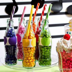 "Talk about eye candy! Add a soda-shoppe vibe to your candy buffet with candy ""pop."""
