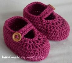 Handmade crocheted baby shoes loafers with buttons.  These baby shoes will keep your baby's little feet cozy and warm.   The boots look beautiful a...
