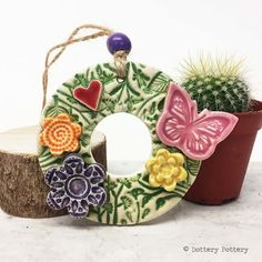 Small ceramic floral wreath decoration butterfly and flowers pottery butterfly £10.00