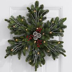 Give a gift as beautiful as fresh snow on Christmas morning. This stunning snowflake wreath is handcrafted with fresh, fragrant Noble Fir and decorated with painted pinecones, red faux berries, and… Decoration Christmas, Noel Christmas, Rustic Christmas, Winter Christmas, Christmas Ornaments, Holiday Decor, Christmas Morning, Christmas Ideas, Diy Christmas Wreaths
