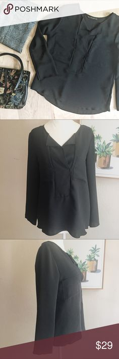 Zara Black Blouse Double Pockets What would this versatile Zara Basic top NOT go with?? Zara flowy black blouse with double front pockets and a loose fit. The sleeves hang loose and flowy. Size small. See measurements in pictures. In very good preowned condition. No stains, holes, or significant wear. 100% polyester. Dry clean. Zara Tops Blouses