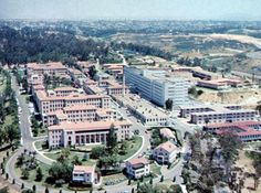 Old Naval Hospital 1950's aerial shot, San Diego, California. The original 1920's Spanish colonial complex has almost all been demolished excepts for the Administration building and chapel. The 1950's white International style surgical wing seen to the right is still standing.