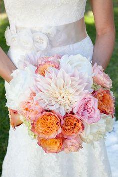 Lovely orange and pink wedding bouquet via thelovelyfind.com