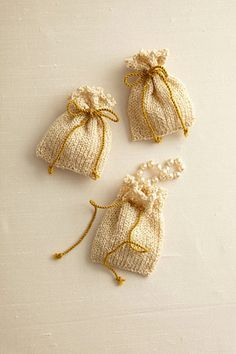 Sachet ~ knit pattern  Can be used as wedding favor bags, fill with dried lavender for sweet smelling sachet for drawers or under your pillow.  Nice!  :)