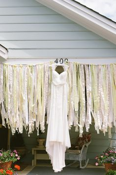 I like these fabric strips hanging from a string - cute easy decoration (old bed sheets!?) A Handmade Backyard Wedding | Glamour & Grace
