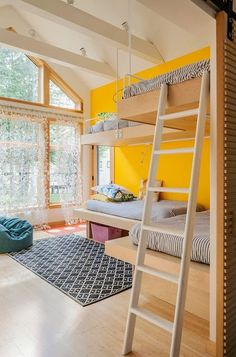 beautiful and bright, yellow wall and light wood.  #kids #decor