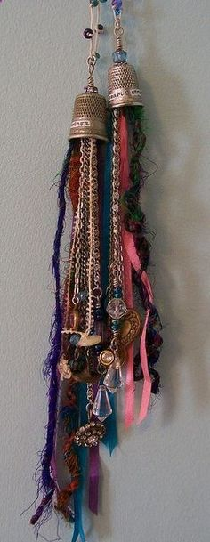 Necklaces using vintage thimbles, beads, buttons, baubles and fibres.