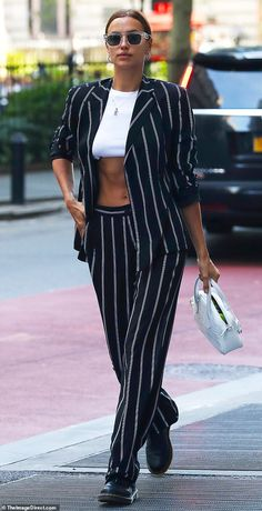 Irina Shayk flaunts her toned abs in a crop top and pinstripe suit, before she took over the runway Pinstripe Suit Women, Crop Top Outfits, Summer Outfits, Suit Fashion, Fashion Outfits, Dope Fashion, Fashion Pants, Black And White Suit, Tv Show Outfits