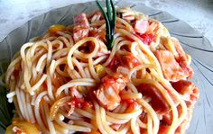 Spaghetti with ham.  Ingredients: 1 packet pasta 200 ml olive oil 1 canned ham 1 large bell pepper 1 tin chopped tomatoes 1 onion salt, pepper, basil, rosemary