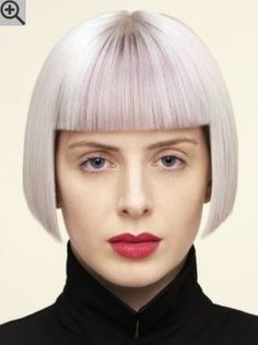 Precision cut helmet shape bob hairstyle with blunt bangs. Silver hair color with lilac streaks.