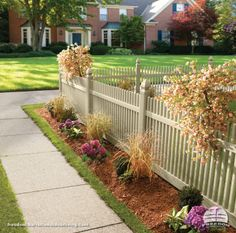 Front yard garden and pretty picket fence with decorative posts. Freedom fencing built by Barrette and manufactured exclusively for Lowe's.