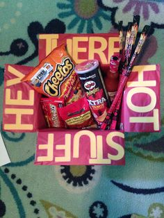"""""""Hey there hot stuff"""" carepackage! Includes: flamin hot Cheetos, buffalo wing Pringles, habanero slim jim, Frank's redhot sauce, hot tamales and spicy peanuts"""