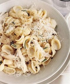 Parmesan pasta with chicken and rosemary. This is so easy to make with a shredded rotisserie chicken, a little fresh rosemary, and freshly grated Parmesan.  - I'd add some frozen peas and carrots to give it color.